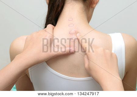 Chiropractor examines spinal column of patient woman medical concept