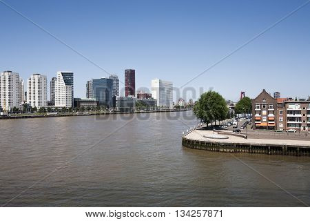 Rotterdam seen from the Erasmus bridge with the city center on the left side and the noordereiland on the right side