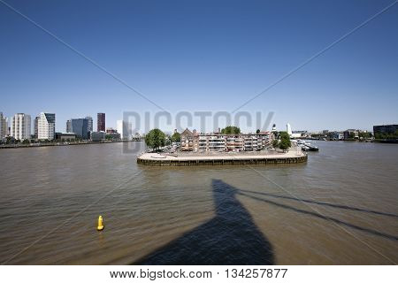 Rotterdam seen from the Erasmus bridge and its shadow