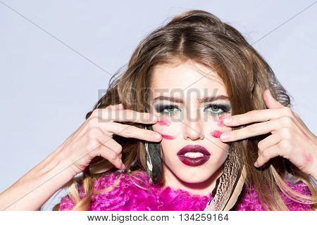 Woman With Indian Feather And Makeup