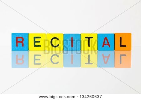 Recital - an inscription from children's wooden blocks