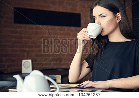 Young Girl Drinking Tea In Cafe