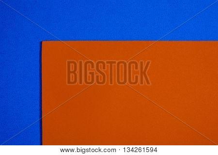 Eva foam ethylene vinyl acetate smooth orange surface on blue sponge plush background