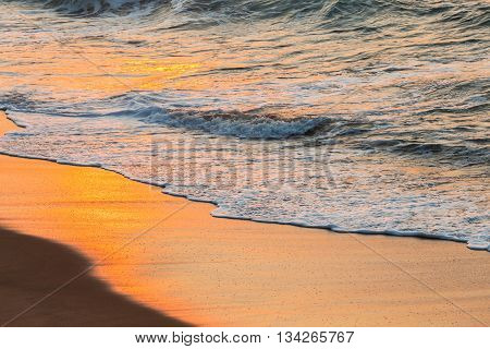 Beach sands ocean waterline sunrise color reflections of nature
