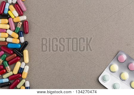 Decorate border from various colorful capsules and colorful pill blister pack