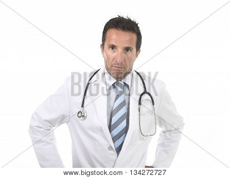 40s attractive male medicine doctor with stethoscope wearing medical gown in worried and stress face expression posing in corporate portrait isolated on white background