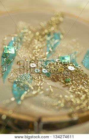 Gold thread and sequins clothing design embroidery in tambour poster