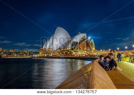 People By The Sydney Opera House At Night