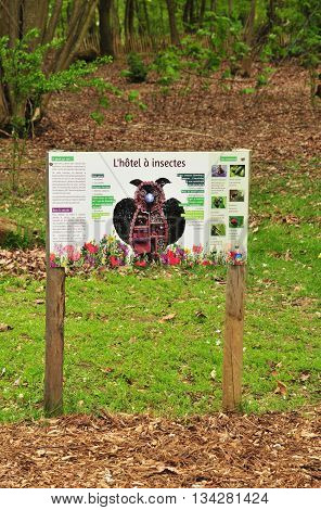 Evreux France - april 29 2016 : insect hotel sign in the Trangis castle park
