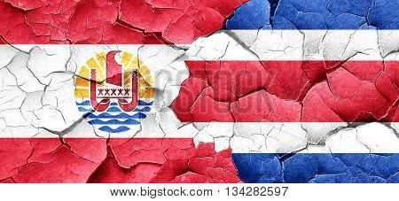 french polynesia flag with Costa Rica flag on a grunge cracked w