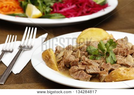 meat sauteed mushrooms and salad food image