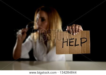 drunk alcoholic blond woman drinking red wine glass asking for help holding message board depressed wasted and sad isolated on black background in alcohol abuse and housewife alcoholism