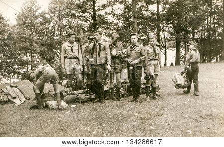PLOCICZNO, POLAND, CIRCA 1957: Vintage photo of  group of scouts during a summer camp