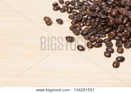 Coffee beans on wood table with copyspace for text. Coffee background or texture concept