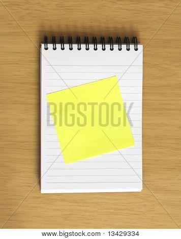 Blank Postit On Notebook On Desk