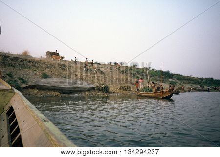 PAGAN / MYANMAR - CIRCA 1987: A boat prepares to depart from the shore of the Irrawaddy River.