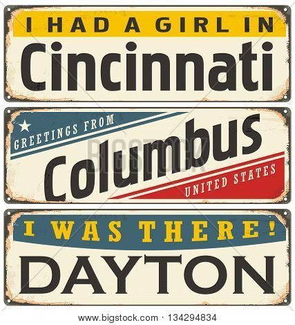 Retro tin sign collection with USA city names. Travel souvenirs on grunge damaged background.