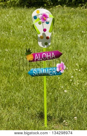 A tropical yard stake decoration for welcoming summer