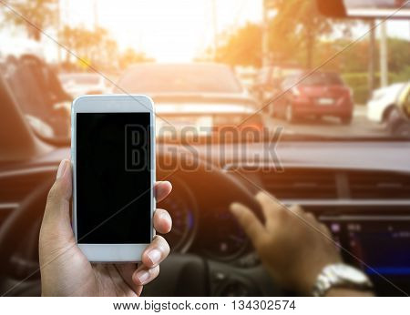 Man using a smartphone while driving a car - Sunset filter effect