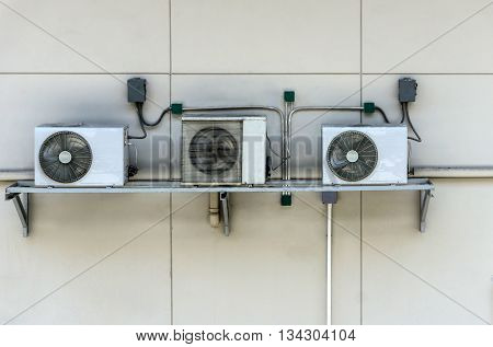 Air Conditioning Compressor In White Wall