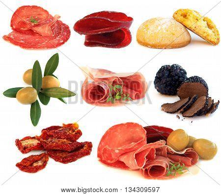 Italian cuisine gourmet food antipasti - prosciutto; salame truffle olive and sun-dried tomato isolated