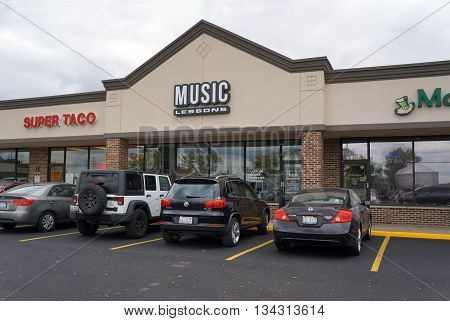 JOLIET, ILLINOIS / UNITED STATES - OCTOBER 9, 2015: One may take music lessons at Bristol Grove Music, in the Crossroads Plaza.