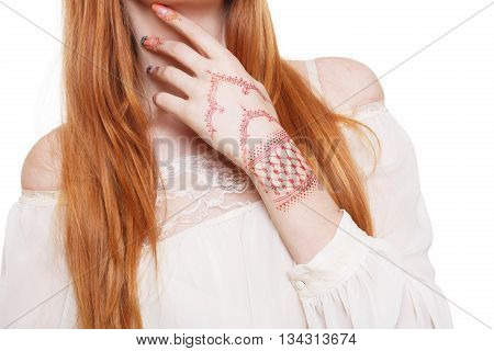 Hand with henna tattoo closeup. Indian hippie style. Fashion boho chic styled young woman with long red hair in white blouse with henna tattoo. Boho style girl unrecognizable, isolated