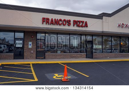 JOLIET, ILLINOIS / UNITED STATES - OCTOBER 9, 2015: One may eat pizza at Franco's Pizza restaurant, in the Crossroads Plaza.