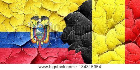 Ecuador flag with Belgium flag on a grunge cracked wall
