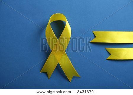 Yellow ribbon on blue background