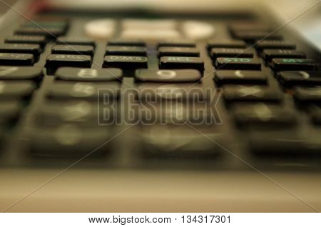 the keyboard of a black calculator in my office