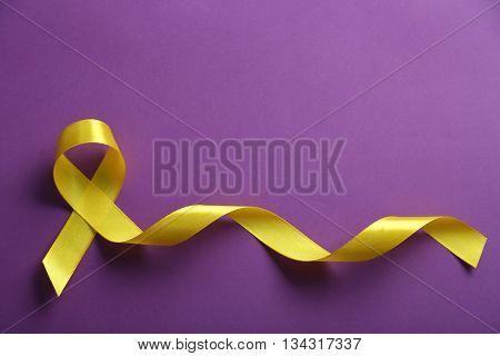 Yellow ribbon on purple background