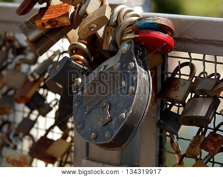 Padlock with the bridge. Bydgoszcz, Poland - June 05, 2016 Metal padlock fastened by the inhabitants of Bydgoszcz and tourists on the railing of the bridge over the river Brda.