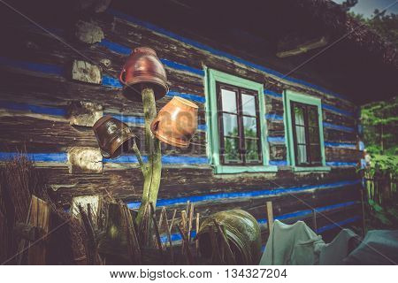 Vintage Housing with Ceramic Crocks on the Wooden Fence. Old Wooden House in the Middle of the Europe.