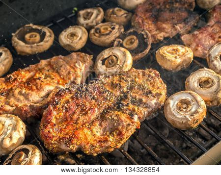 Pork butt chops being grilled on barbecue