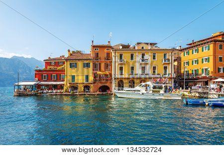 Colorful houses the bay of ancient italian town malcesine at garda lake veneto region italy