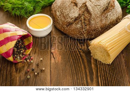 Baked bread with pasta greens oil and pepper on wooden table background for lunch