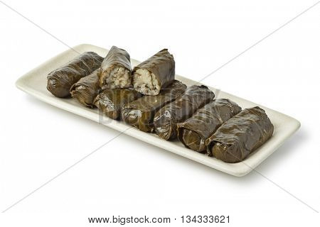 Traditional greek dolmades on a dish on white background
