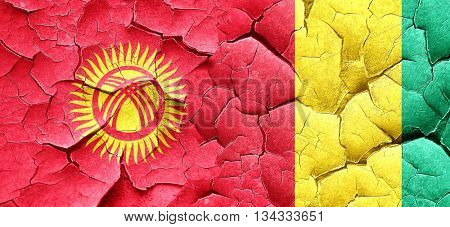 Kyrgyzstan flag with Guinea flag on a grunge cracked wall