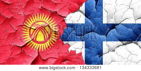 Kyrgyzstan flag with Finland flag on a grunge cracked wall
