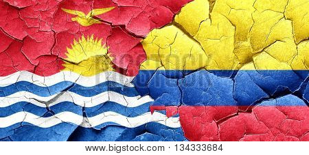Kiribati flag with Colombia flag on a grunge cracked wall