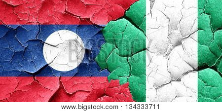 Laos flag with Nigeria flag on a grunge cracked wall
