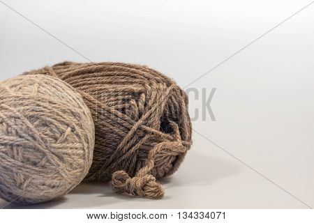 Dryer Ball and Wool Yarn with White Space in Landscape Format