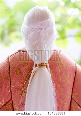 GOMEL, BELARUS - MAY 24, 2015: The Antique Kimekomi Japanese doll old woman Uba depicting a Noh play,