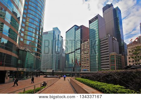 HONG KONG - DECEMBER 11, 2014: Hong Kong Special Administrative Region. Super-modern architectural design of buildings in Hong Kong. Mirrored walls and red marble sidewalks