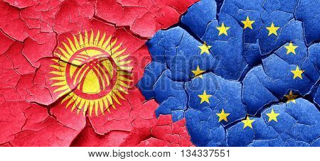 Kyrgyzstan flag with european union flag on a grunge cracked wal