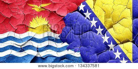 Kiribati flag with Bosnia and Herzegovina flag on a grunge crack