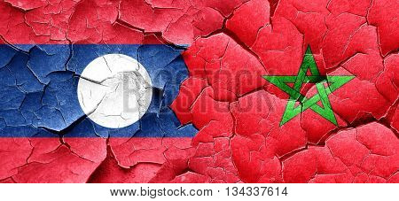 Laos flag with Morocco flag on a grunge cracked wall