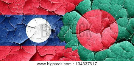 Laos flag with Bangladesh flag on a grunge cracked wall