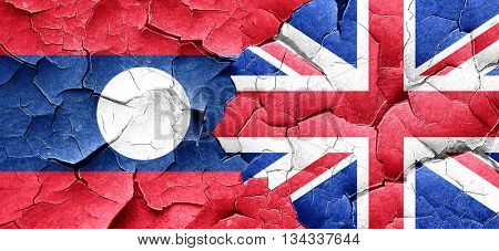 Laos flag with Great Britain flag on a grunge cracked wall